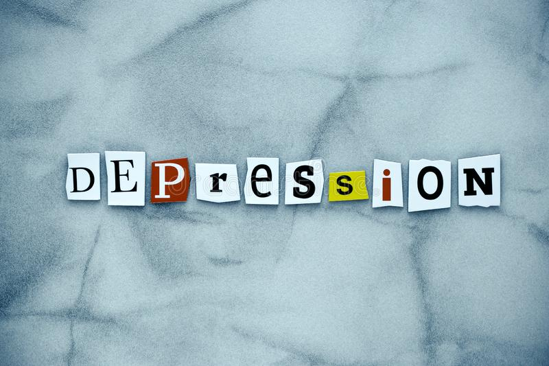 Word depression of cut letters on gray background. A word writing text showing depression. Abstract card with an inscription on gr. Ey backdrop. Psychologic stock photography