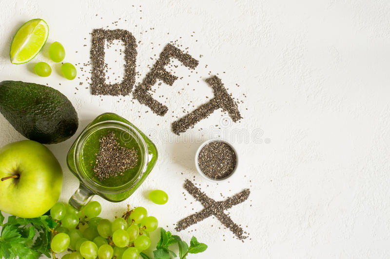 Word detox is made from chia seeds. Green smoothies and ingredie. Nts. Concept of diet, cleansing the body, healthy eating. Top view with copy space stock photos