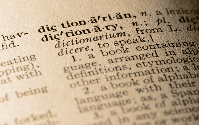 The word dictionary. Close-up of the word dictionary and its definition stock image