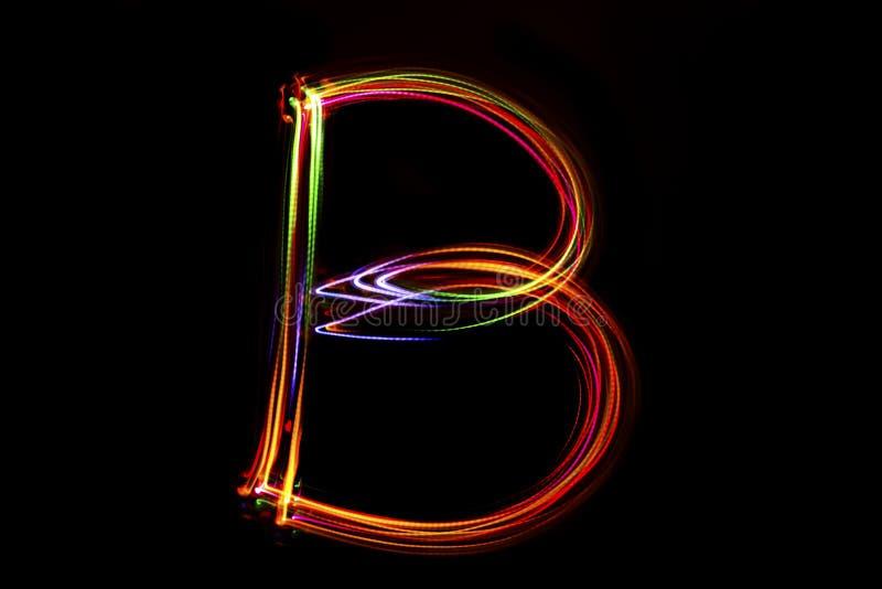Word ` die B ` van licht schrijven royalty-vrije stock afbeeldingen