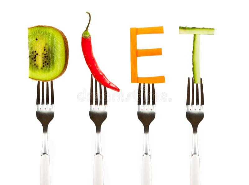 Word dieet van verse smakelijke groenten op vorken wordt gemaakt die stock foto