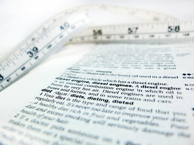 Word diet. Definition of the word - diet, with tape measure close up stock photos