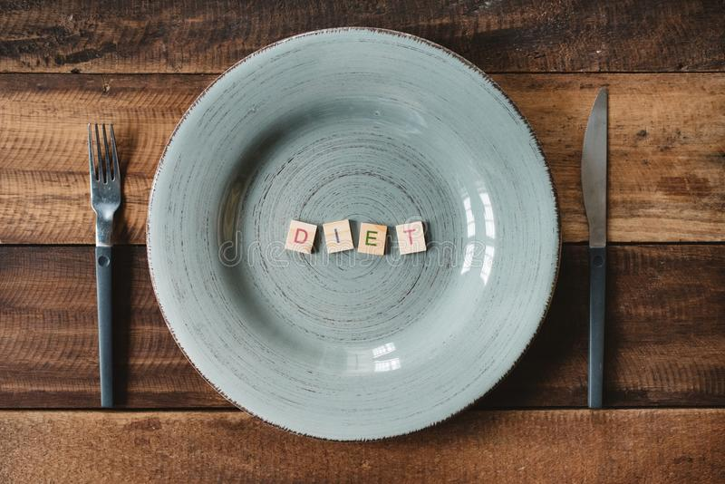A word DIET made from a alphabet tiles in a empty plate. stock image