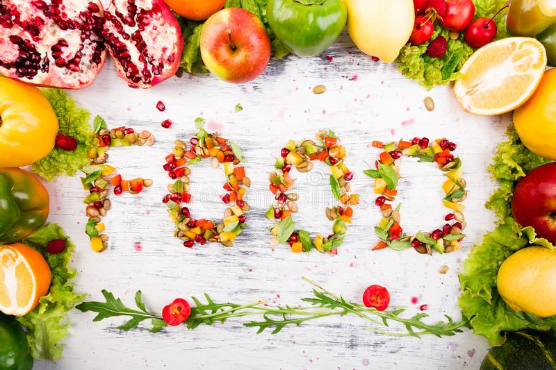 Word food is made from fruite and vegetables. Healthy vegan diet raw food. royalty free stock photography