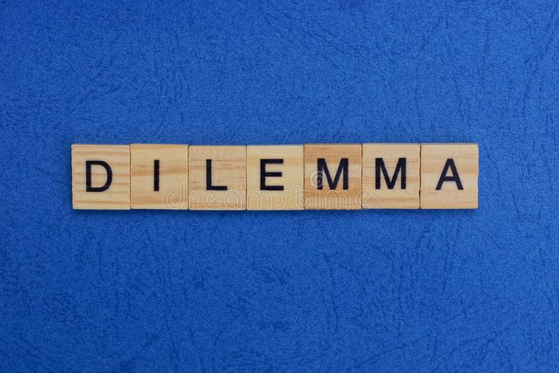 Word dilemma made of wooden letters stock images