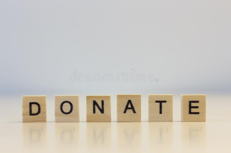 The word Donate on cubes royalty free stock photo
