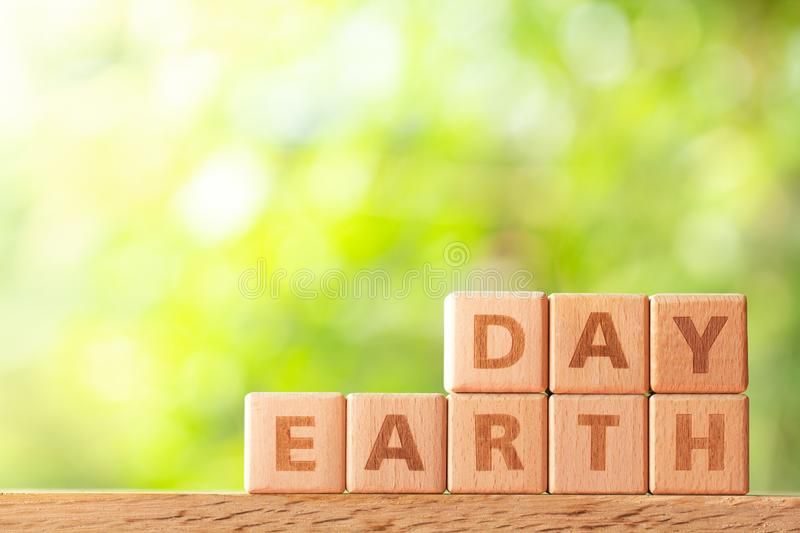Word earth day written on wooden block on wood table stock photos