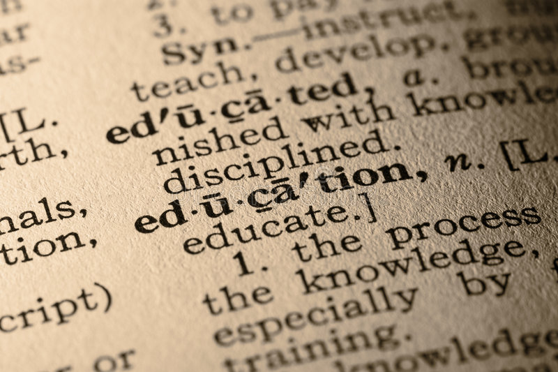 The word education. Close-up of the word education in a dictionary royalty free stock image