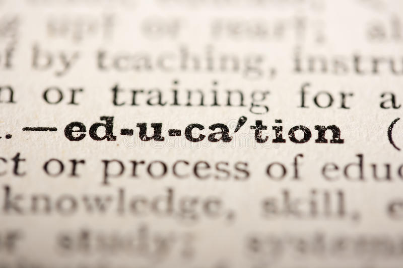 Word education. From the old dictionary, a close up royalty free stock photography