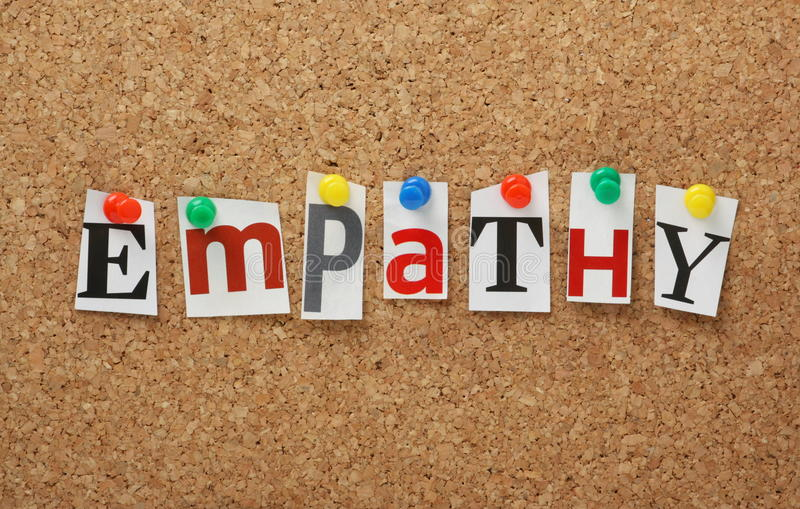 The word Empathy. In cut out magazine letters pinned to a cork notice board. Empathy is the experience of understanding another person from their perspective
