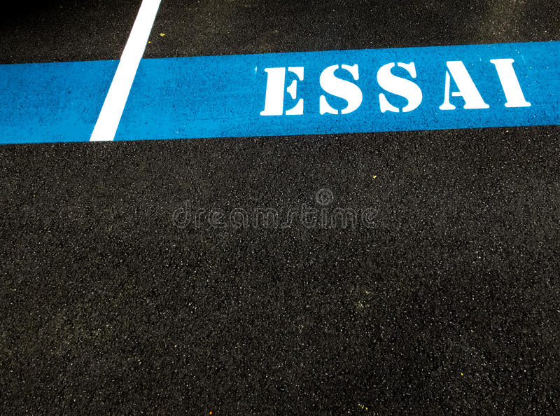 The word ESSAI painted on asphalt stock photos
