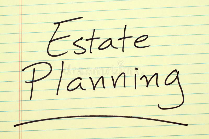 Estate Planning On A Yellow Legal Pad. The word `Estate Planning` underlined on a yellow legal pad royalty free stock images