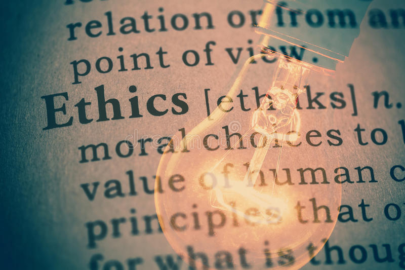 Word Ethics and light bulb. Fake dictionary, definition of the word Ethics stock photos