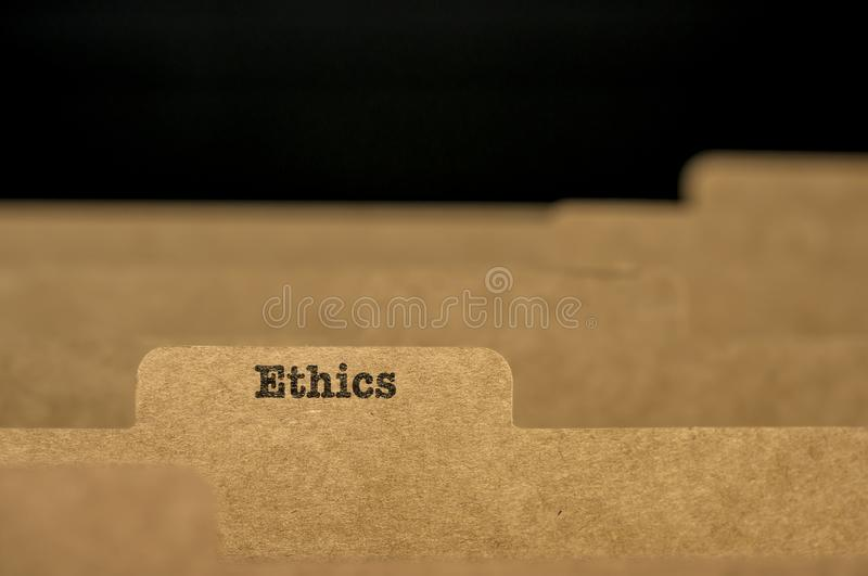 Word ethics on index card. Word ethics written on Index card in filing cabinet royalty free stock image
