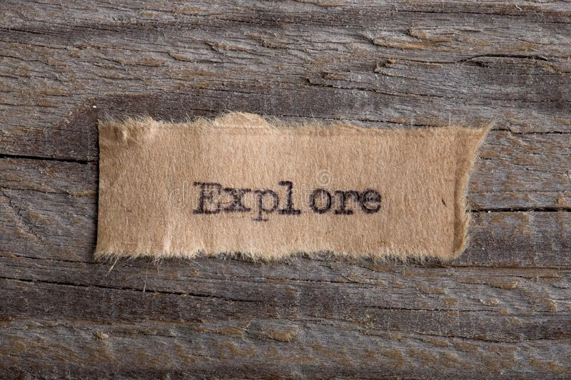 The word Explore typed on a piece of paper. Concept for education, improve and uncover new opportunities. The word Explore typed on a piece of paper. Concept for royalty free stock photo