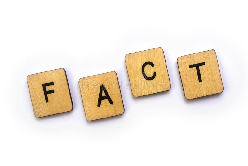 The word FACT. Spelt with wooden letter tiles stock images