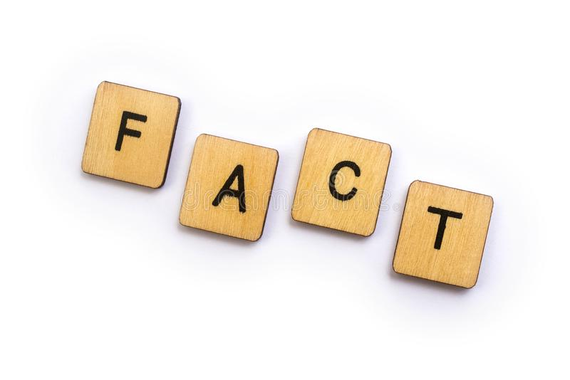The word FACT. Spelt with wooden letter tiles stock photo