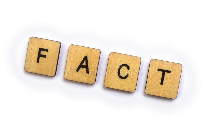 The word FACT. Spelt with wooden letter tiles stock photos