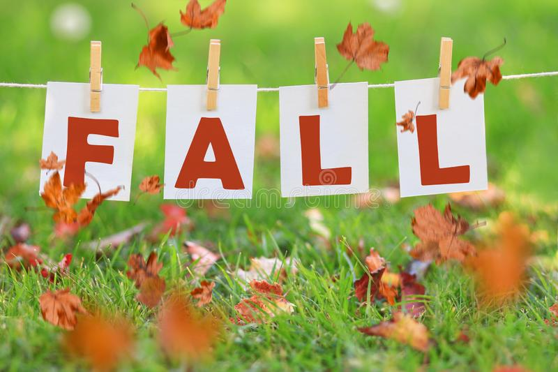 Word fall written on paper hanging in a row stock images