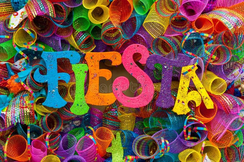 The word `fiesta` written in colorful letters with glitter and multicolored mash stock photos