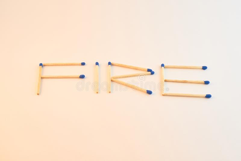 Word Fire made with matches. royalty free stock images
