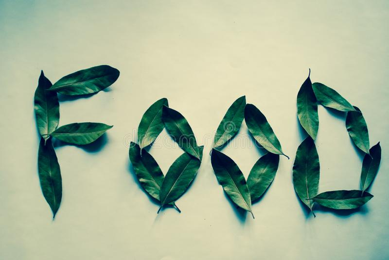 Word Food. Bay leaves. Green filter. royalty free stock image