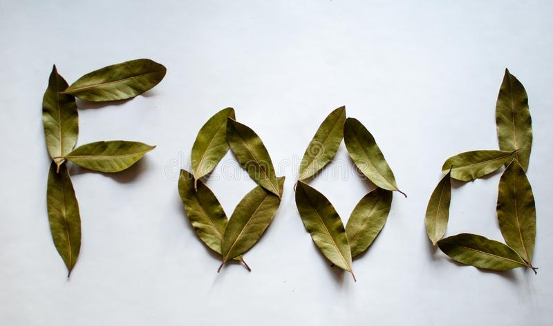 Word Food. Bay leaves on white background. stock images
