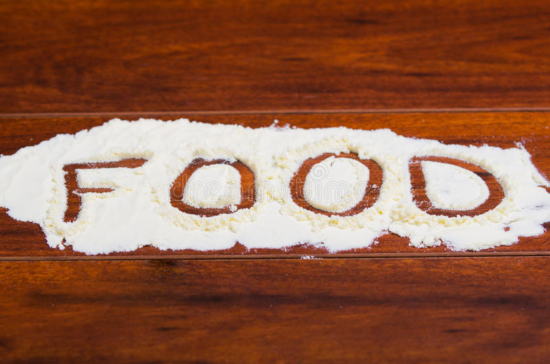 The word food written in stevia powder on wooden background royalty free stock photos