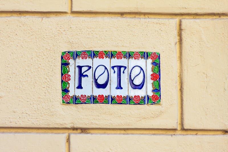 Word foto on decorative ceramic tiles stock images