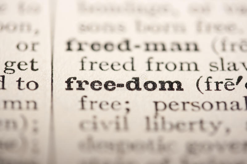 Word freedom. From the old dictionary, a close up royalty free stock photo