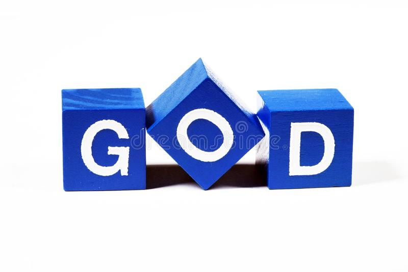 The word `god` spelled out in blue capitals royalty free stock image