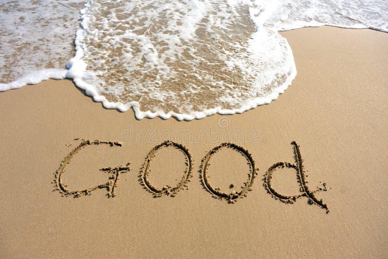Word goed op het strand wordt getrokken dat royalty-vrije stock afbeelding