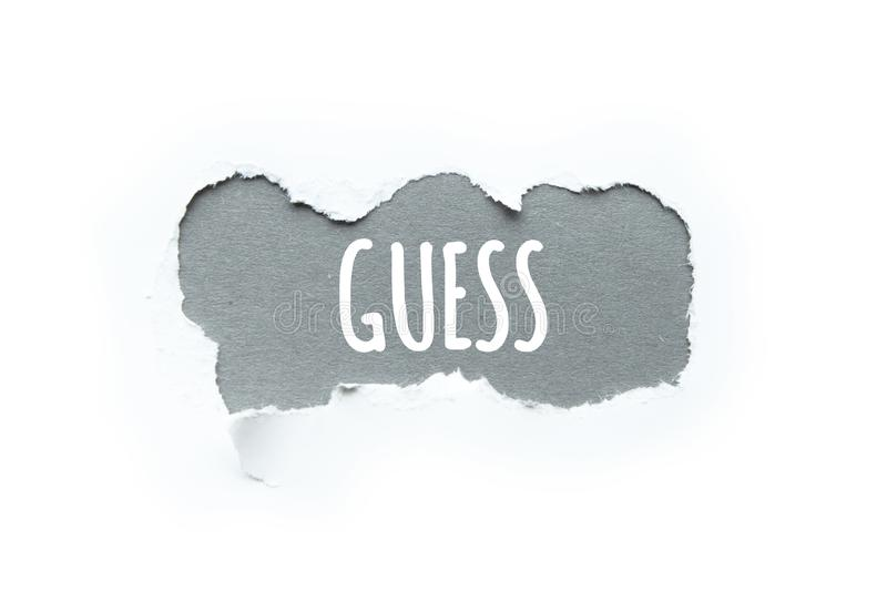 The word `guess` in the rupture of paper, concept. stock images