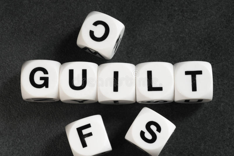 Word guilt on toy cubes. Word guilt on white toy cubes royalty free stock image