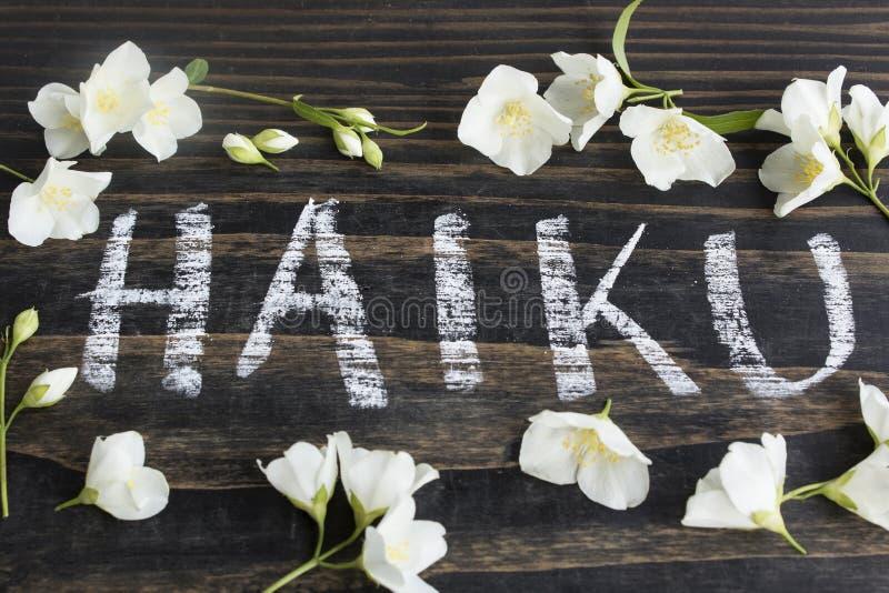Word Haiku, Japanese Poetry, with Jasmine Flowers royalty free stock photos