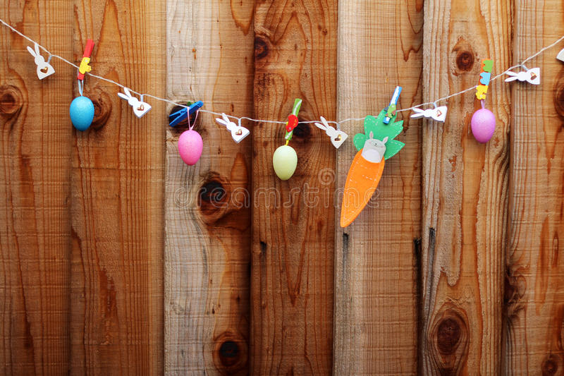 Word Happy on sackcloth tags hanging on a line stock photo