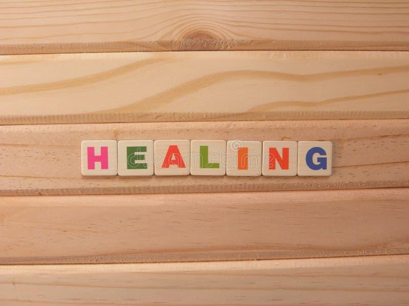 Word Healing on wood royalty-vrije stock afbeelding