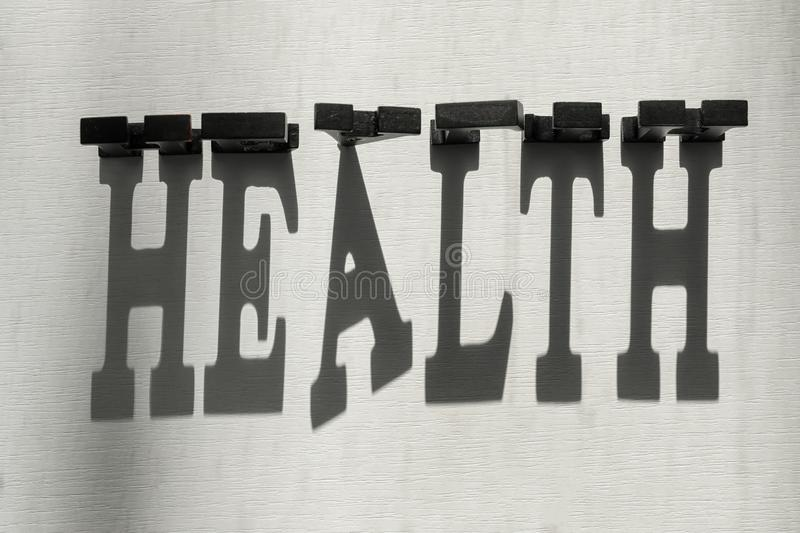 Word HEALTH made of dark letters with shadow on light background stock image