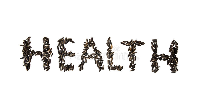 Word Health made of sunflower seeds on the white background stock photography