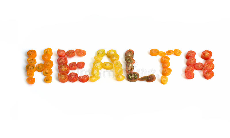 The word health written in slices of cherry tomatoes royalty free stock photos