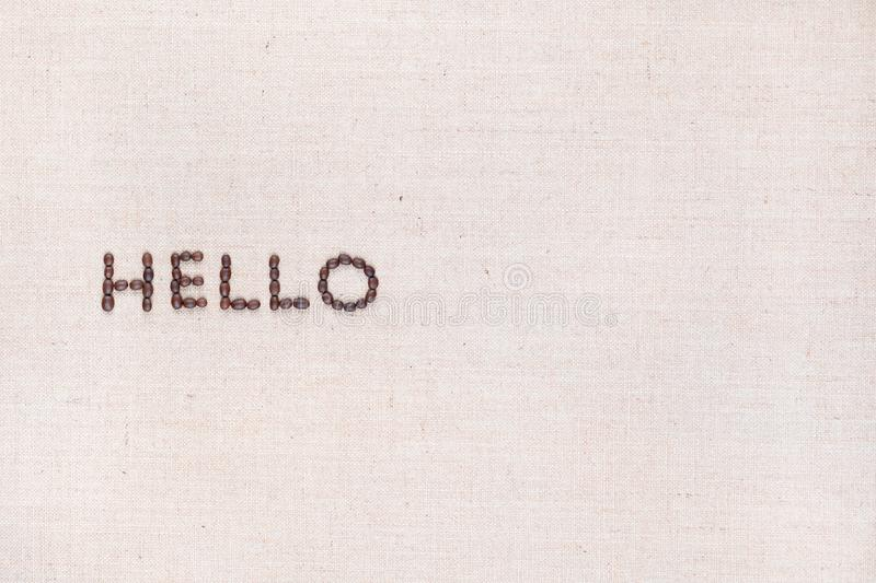The word Hello written with coffee beans shot from above, aligned to the left stock photos
