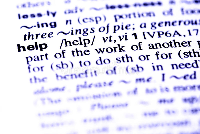 The word help in a dictionary. Close-up of the word help in a dictionary. In blue tone royalty free stock photos