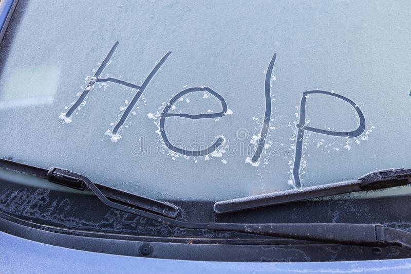 Word help on windshield of car. Word help written on the windshield of frozen car in winter, outdoors stock images