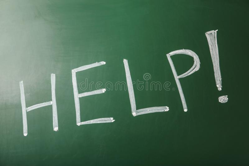 Word `Help` written with chalk royalty free stock images