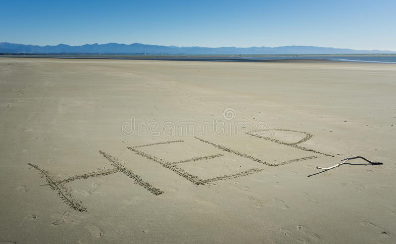 The word HELP written on sand. On the beach royalty free stock image