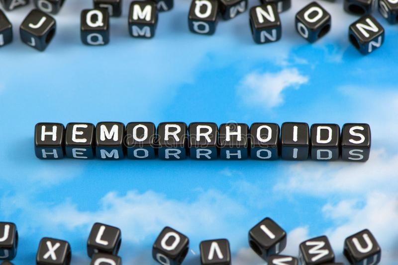 The word Hemorrhoids. On the sky background royalty free stock photo