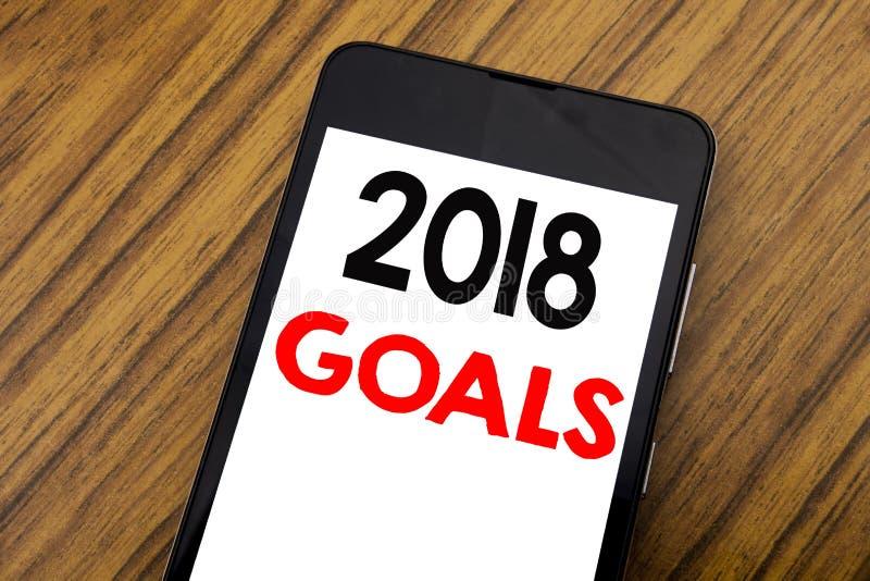 Word, het schrijven handschrift 2018 Doelstellingen Bedrijfsconcept voor Nieuwe Yer Geschreven resoluties over mobiele telefoonce royalty-vrije stock afbeeldingen