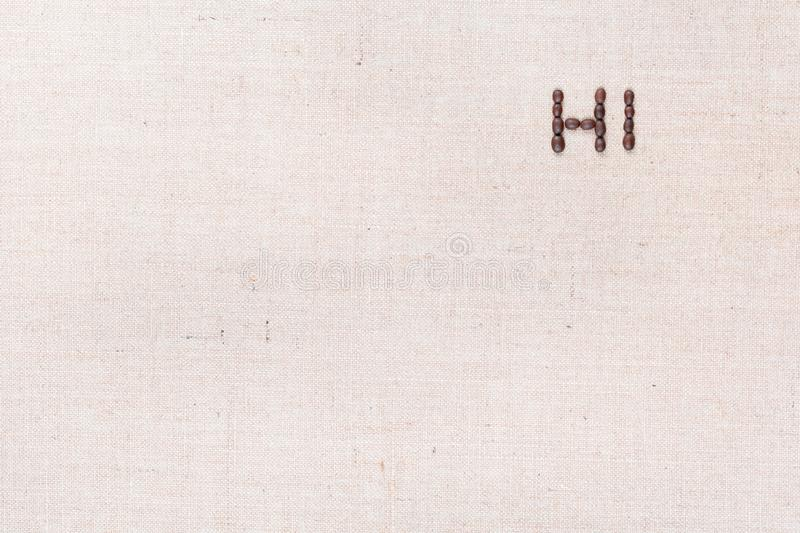 The word Hi written with coffee beans shot from above, aligned at the top right stock photography