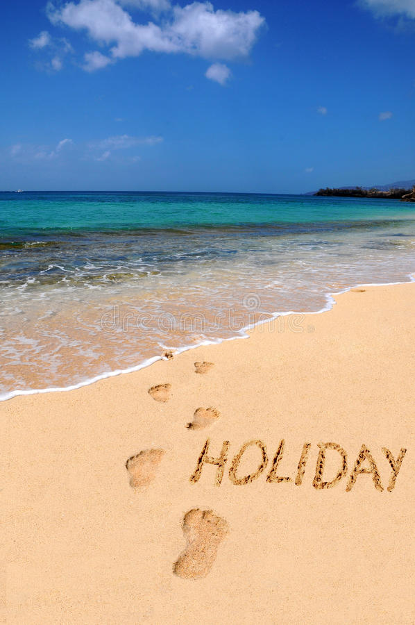 Word holiday on the beach royalty free stock images