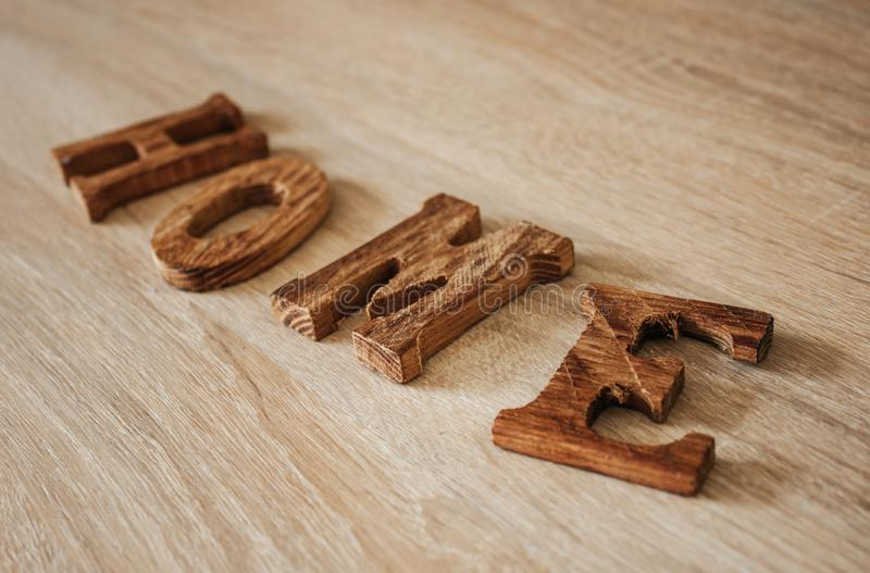 Wooden word HOME stock image